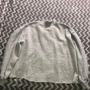 Bottom cut off turtleneck sweatshirt